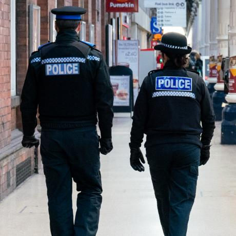 Police community support officers in high street