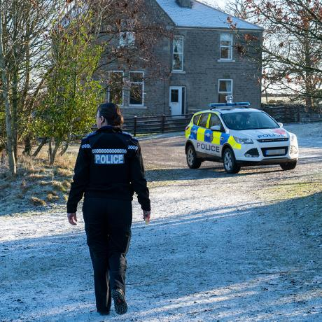 Police officer walking to response car