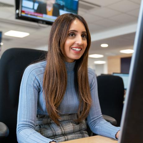 A woman working at a computer