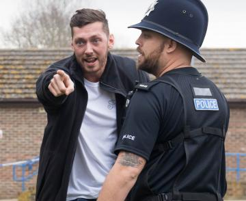 Man pointing with police officer