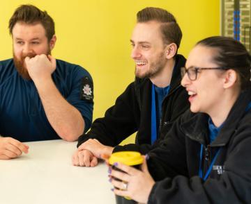 People in their team meeting