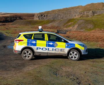 Police vehicle in rural setting